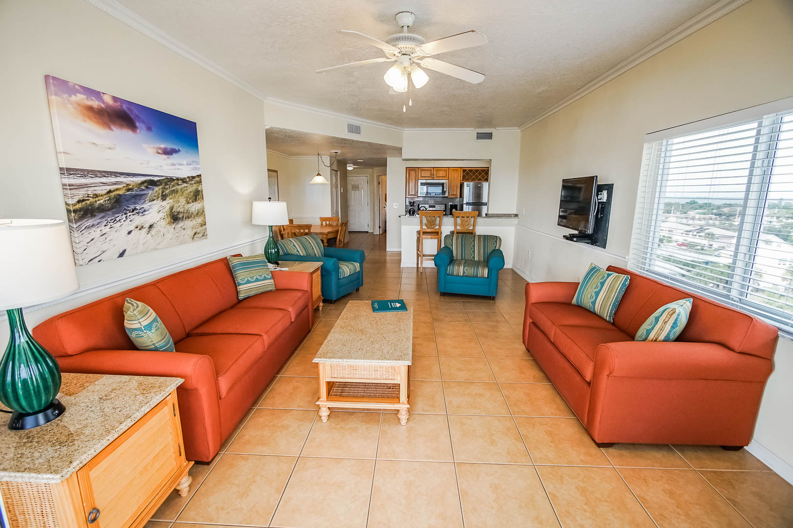 A spacious living room area at VRI's Discovery Beach Resort in Cocoa Beach, Florida.
