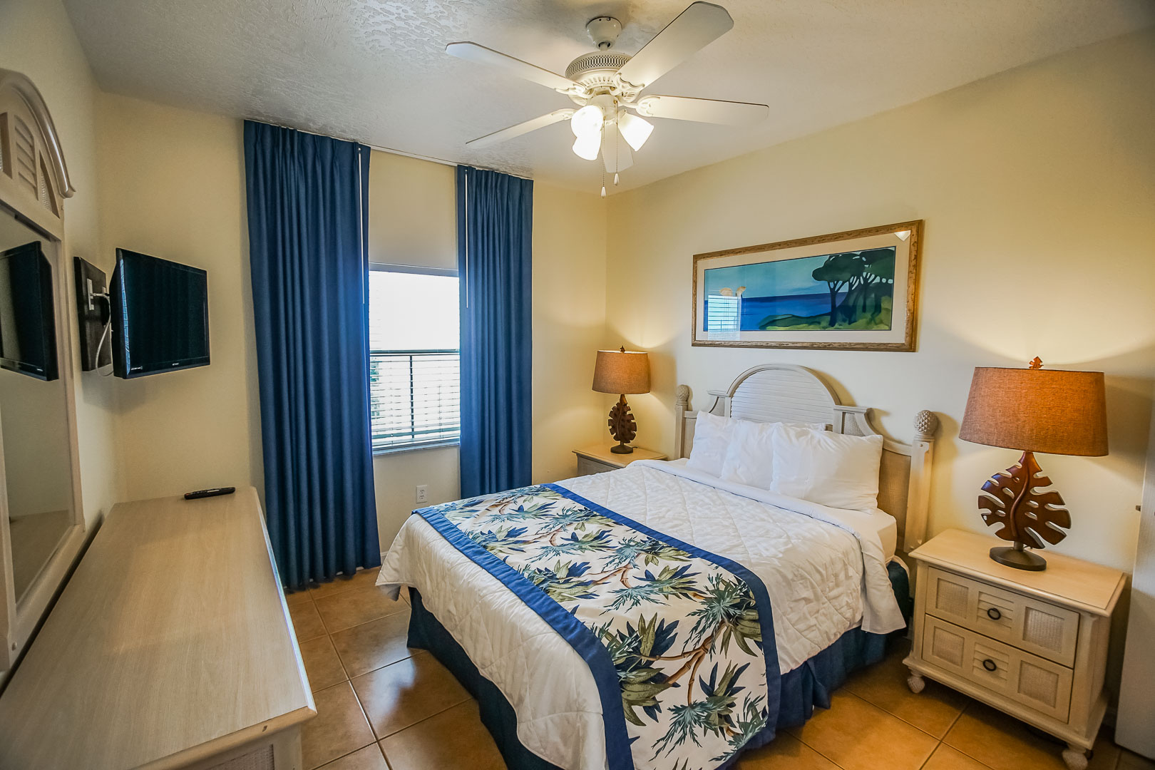 A vibrant master bedroom at VRI's Discovery Beach Resort in Cocoa Beach, Florida.