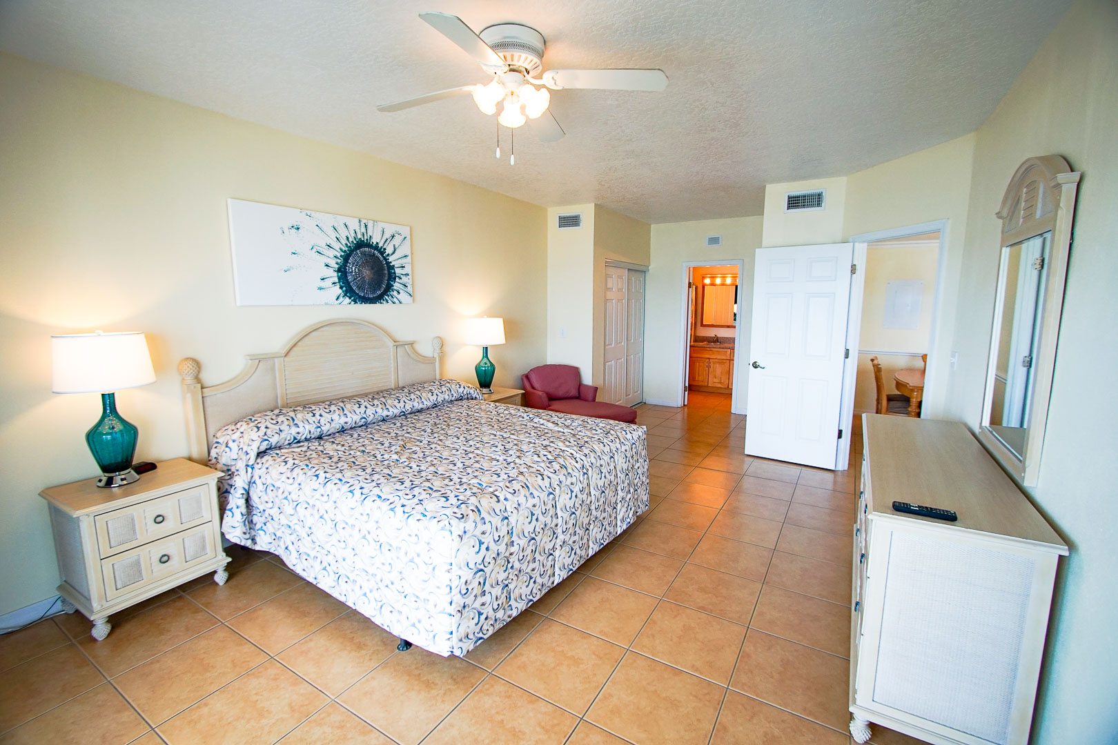 An airy master bedroom at VRI's Discovery Beach Resort in Cocoa Beach, Florida.