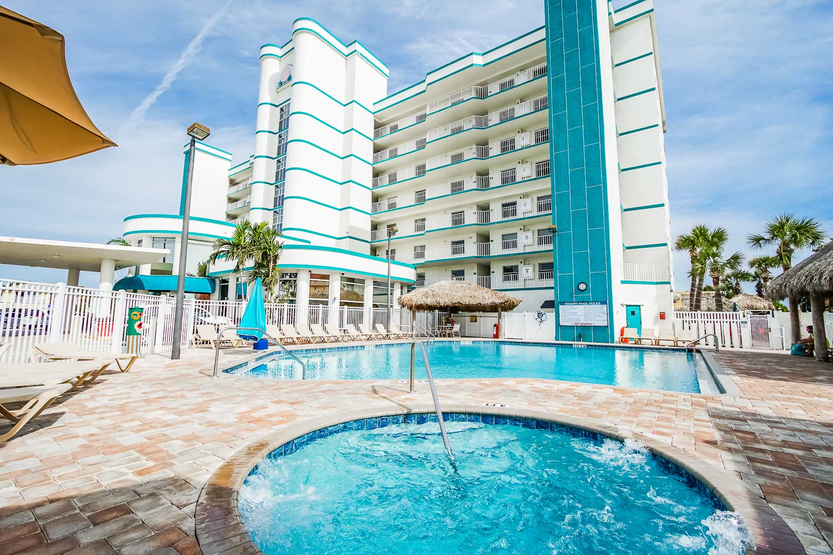 A crisp outdoor swimming pool and Jacuzzi at VRI's Discovery Beach Resort in Cocoa Beach, Florida.