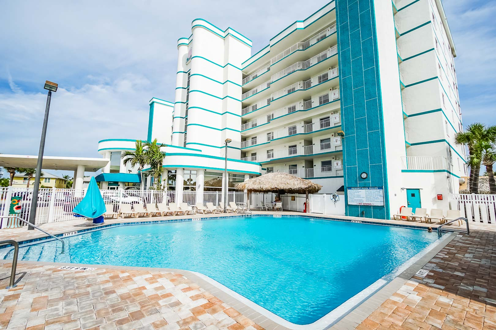 A crisp outdoor swimming pool at VRI's Discovery Beach Resort in Cocoa Beach, Florida.