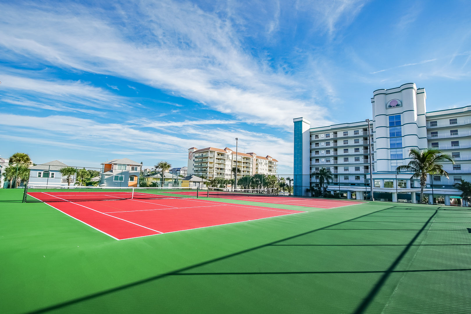 A vibrant outdoor tennis court at VRI's Discovery Beach Resort in Cocoa Beach, Florida.