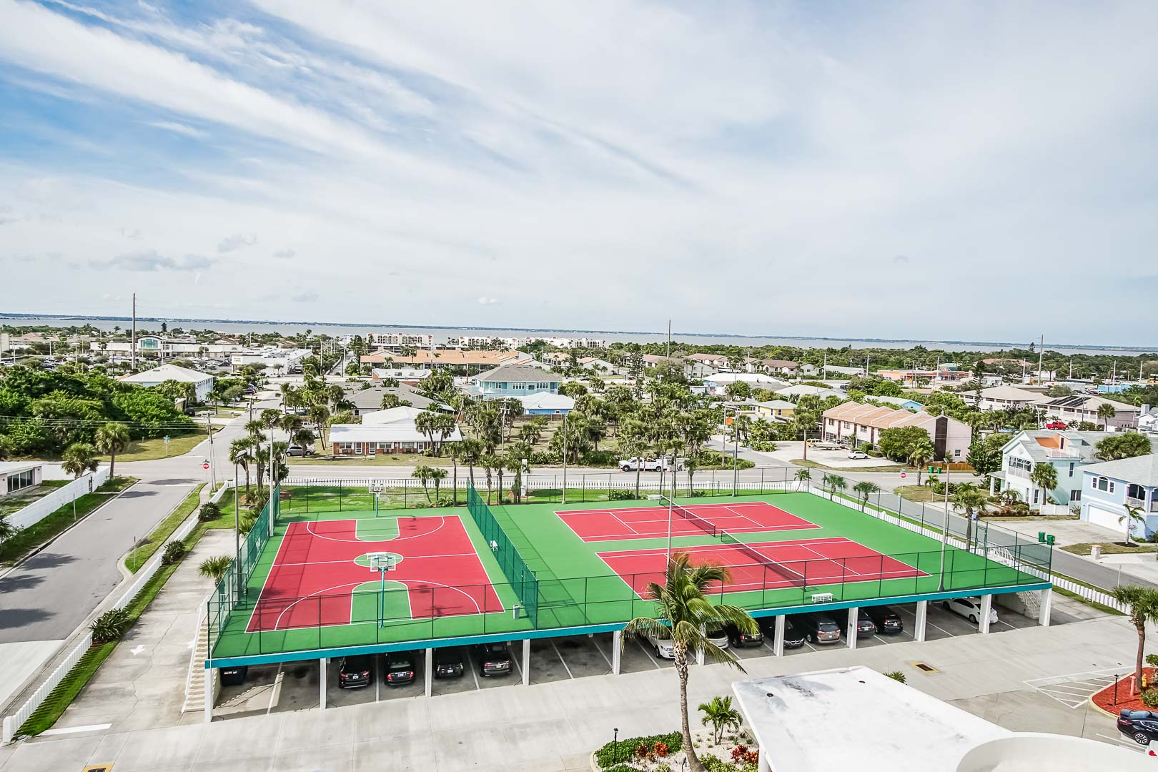 An expansive view of the tennis court and basketball court at VRI's Discovery Beach Resort in Cocoa Beach, Florida.