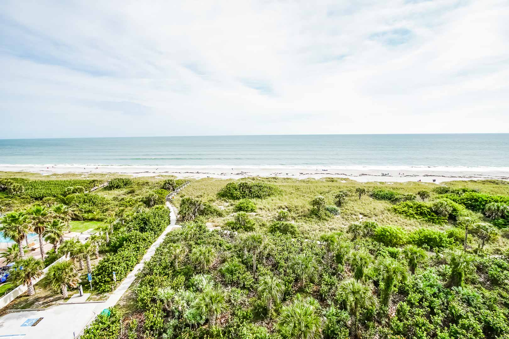 A resort view of the beach at VRI's Discovery Beach Resort in Cocoa Beach, Florida.