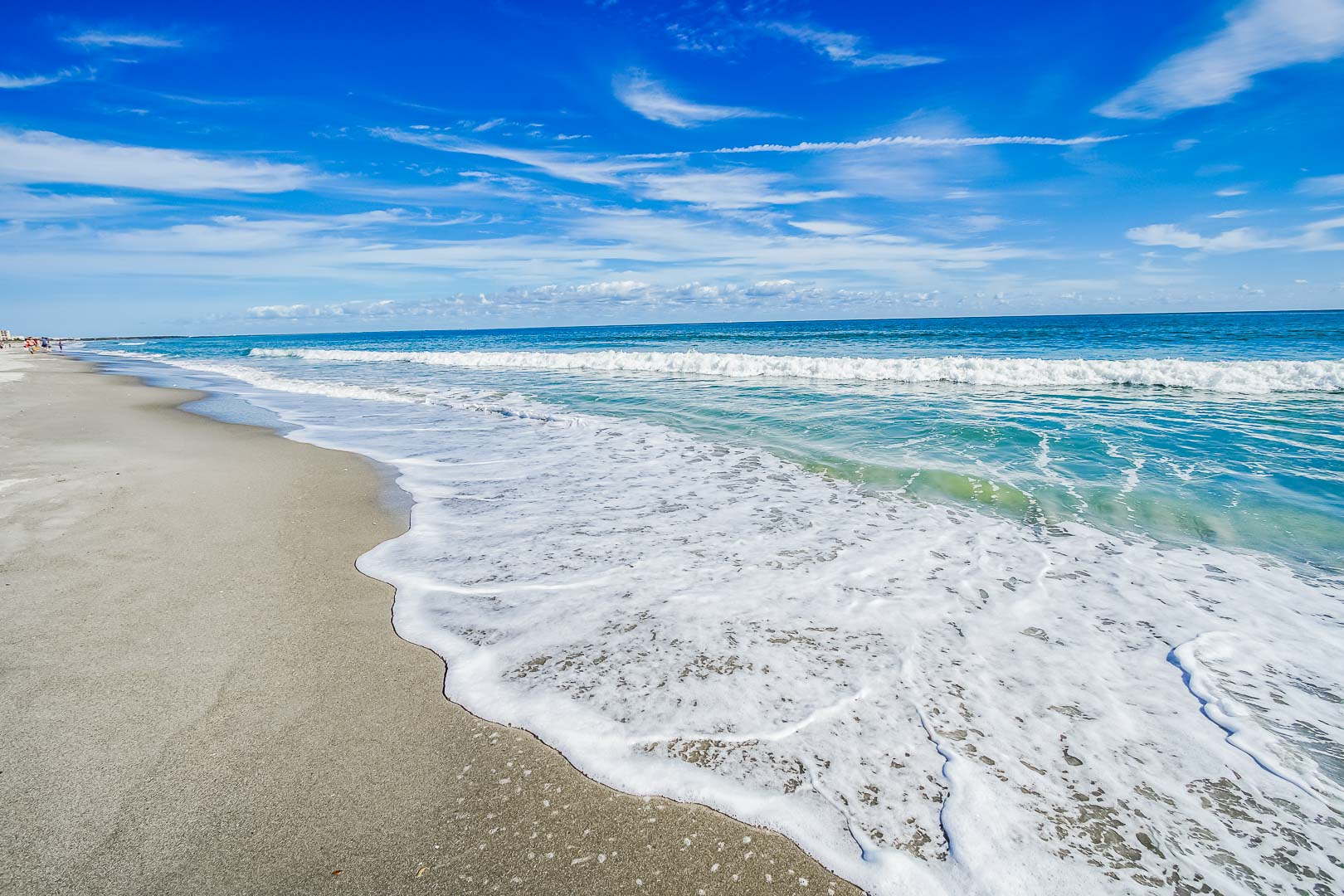 A relaxing view of the beach at VRI's Discovery Beach Resort in Cocoa Beach, Florida.