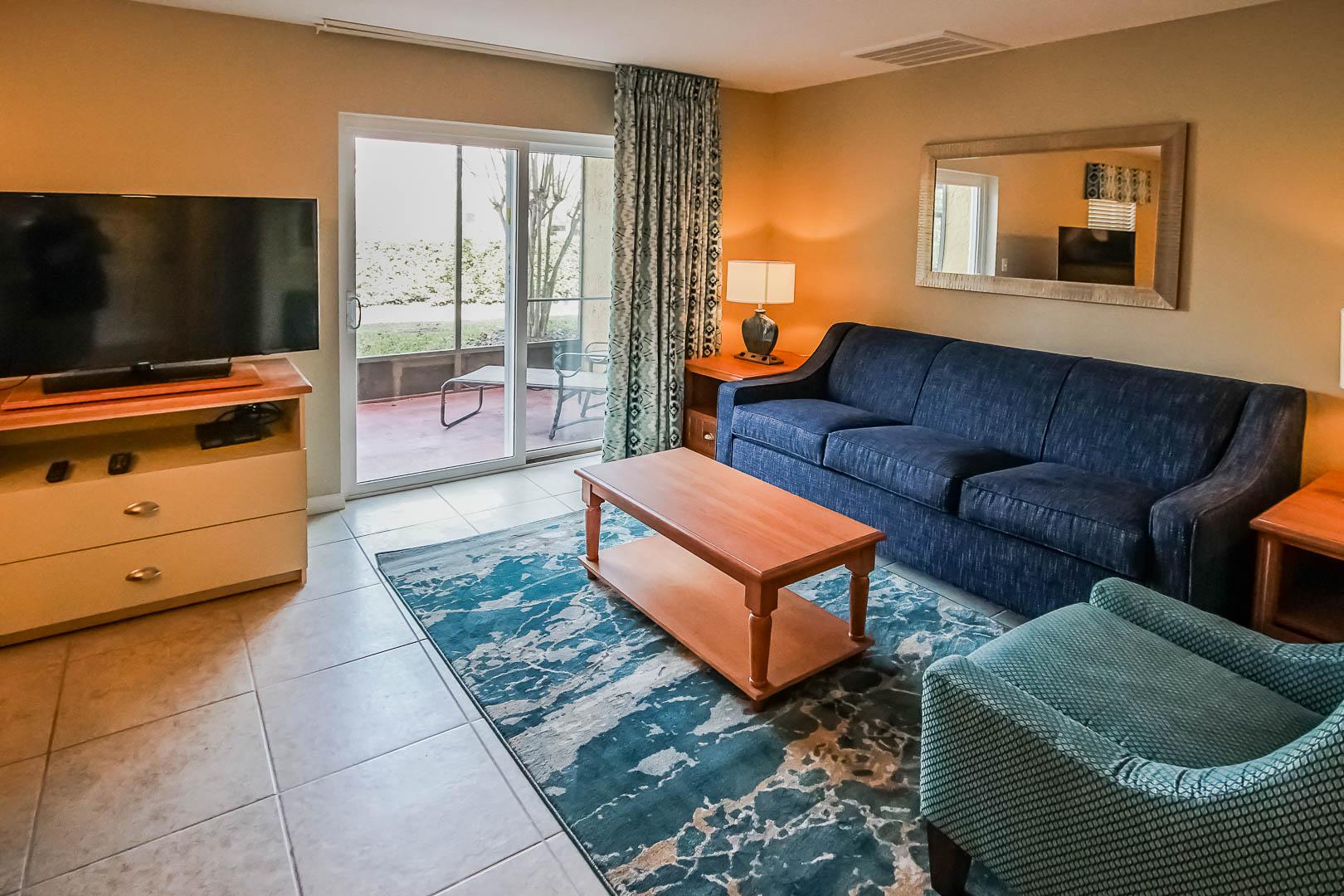 A modern living room area at VRI's Fantasy World Resort in Florida.