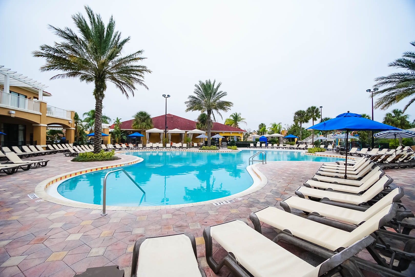 An expansive outdoor swimming pool at VRI's Fantasy World Resort in Florida.