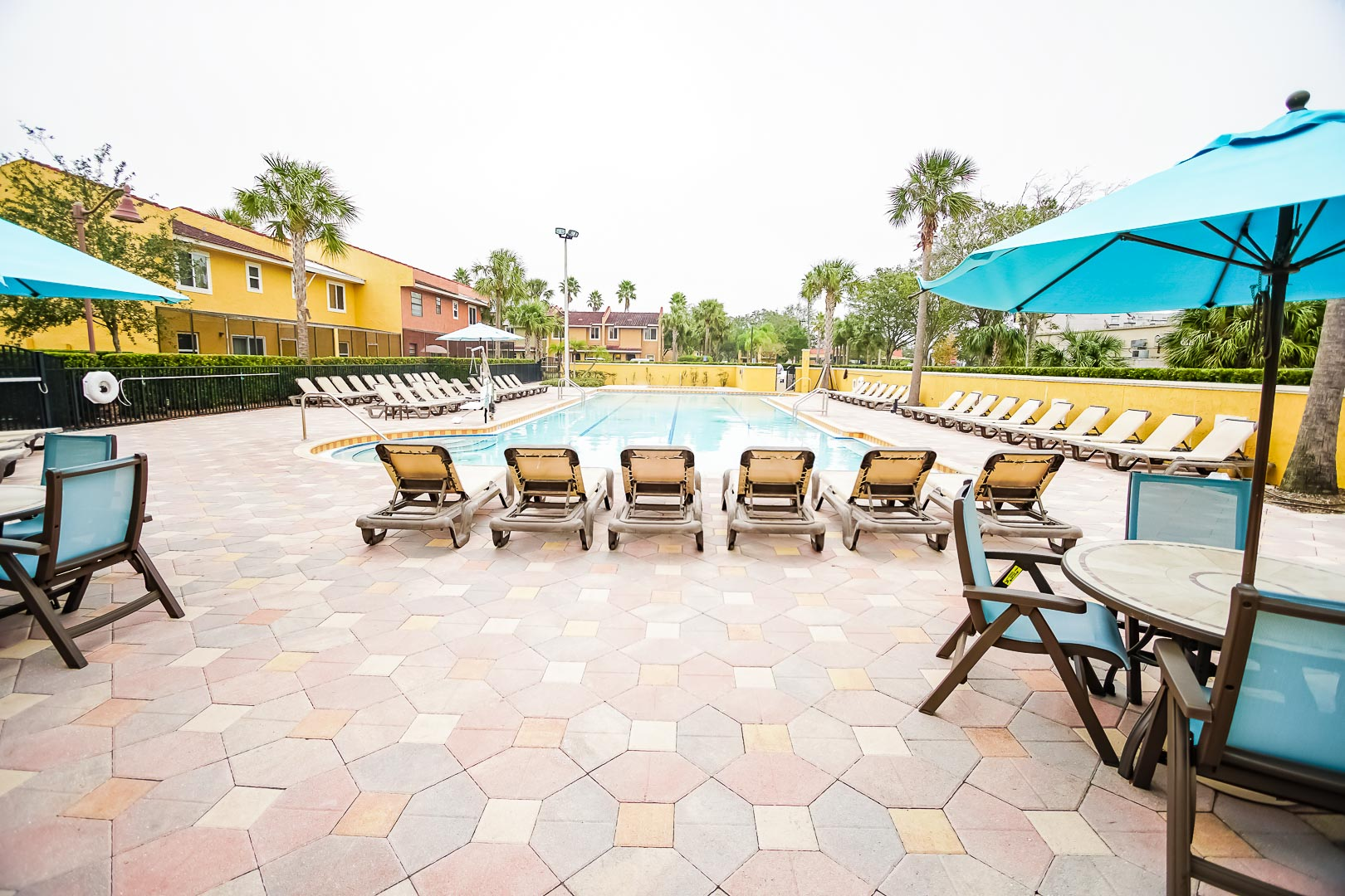 A relaxing view of the outdoor swimming pool at VRI's Fantasy World Resort in Florida.