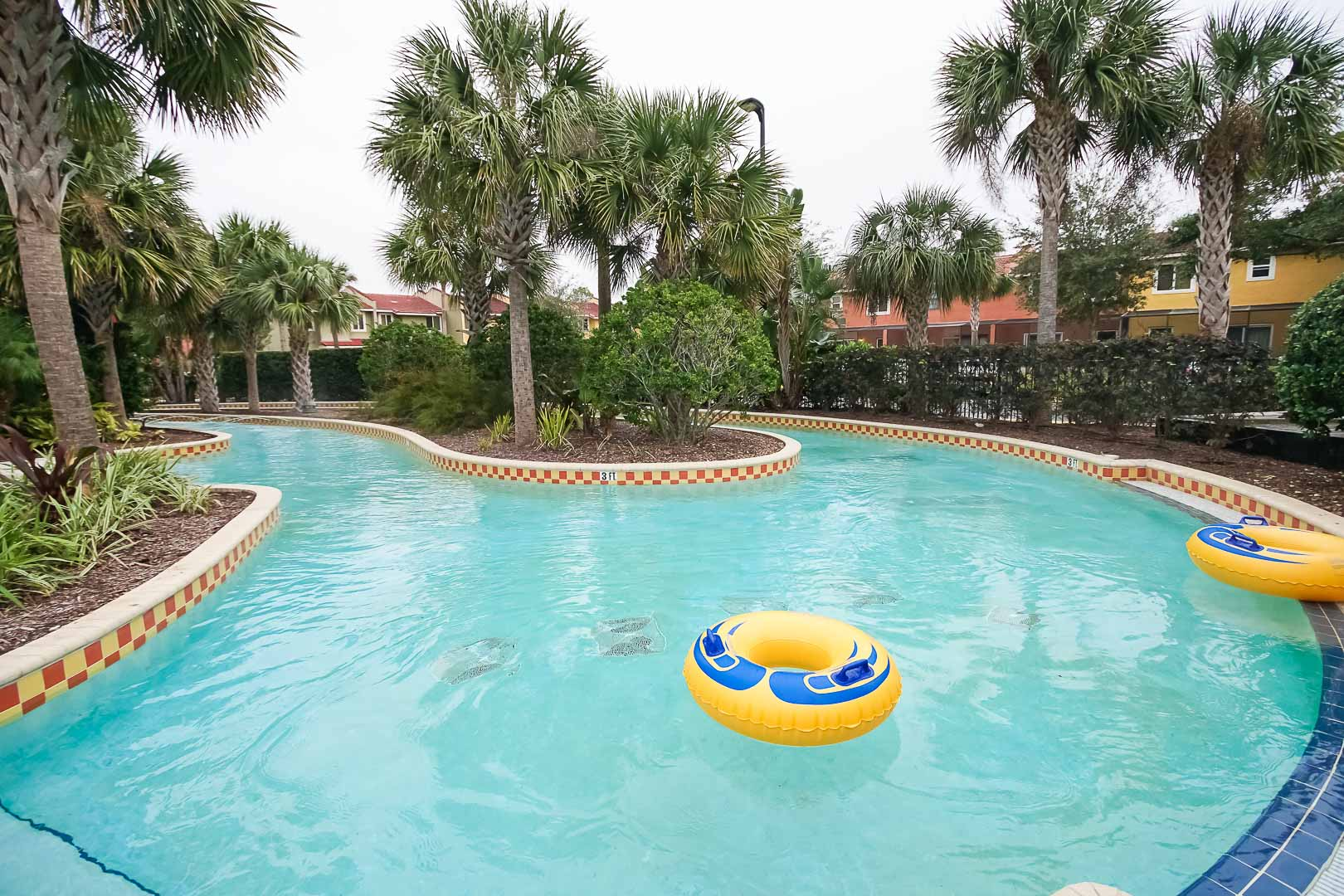 An outdoor lazy river pool at VRI's Fantasy World Resort in Florida.