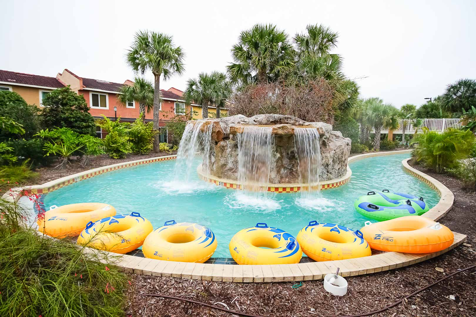 A colorful view of the outdoor lazy river pool at VRI's Fantasy World Resort in Florida.