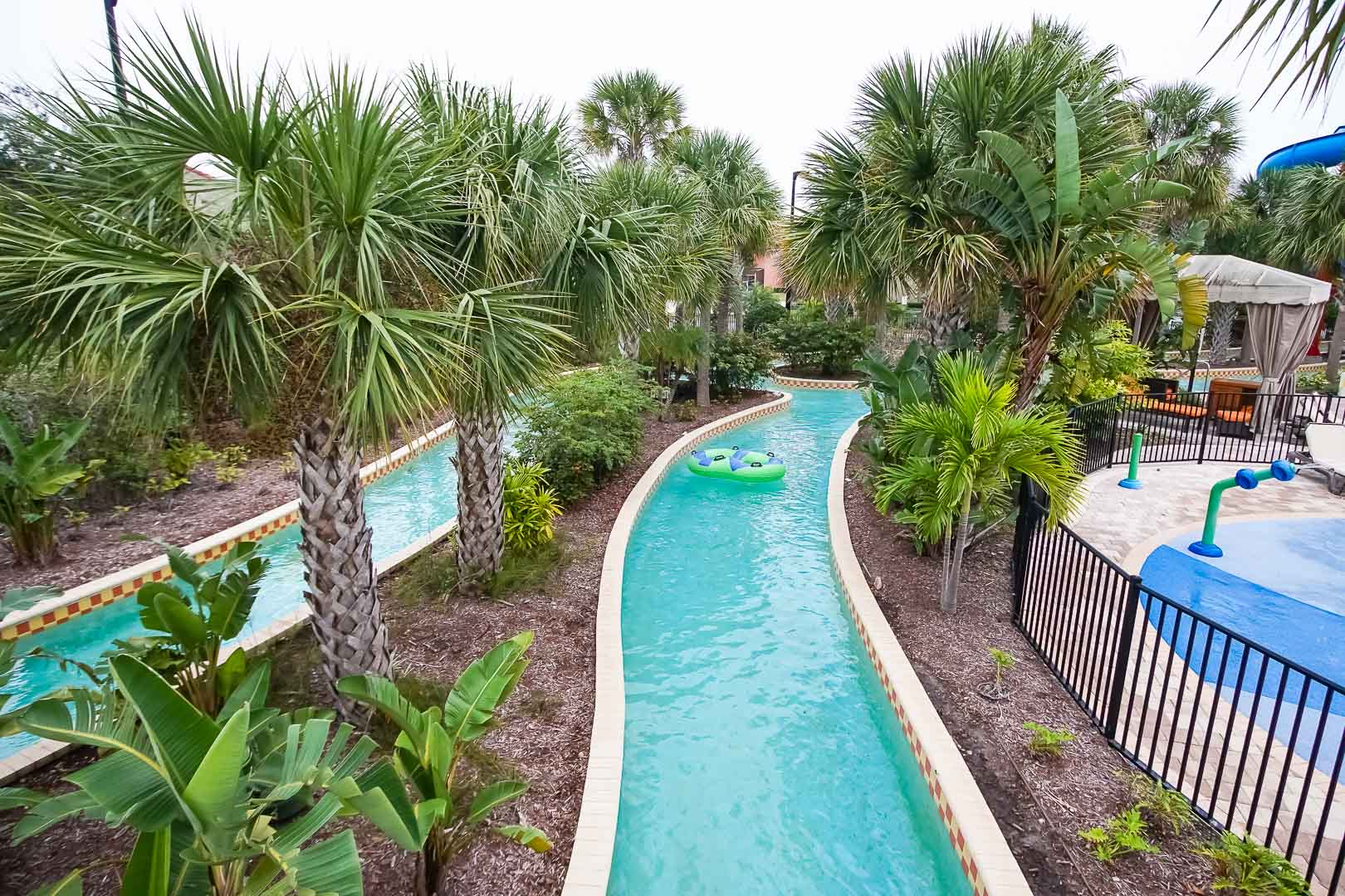 A relaxing view of the outdoor lazy river pool at VRI's Fantasy World Resort in Florida.
