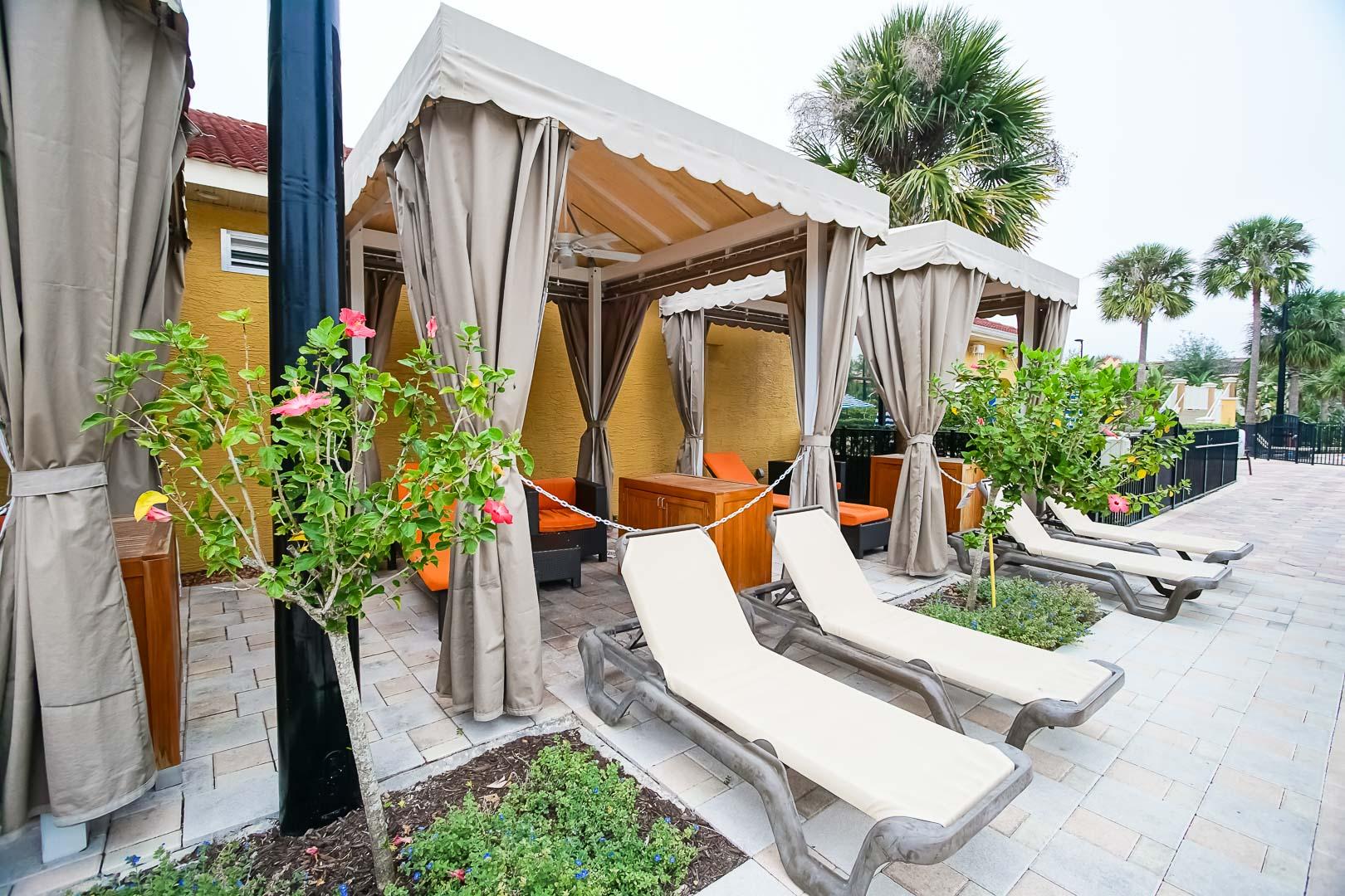 A modern pool lounging area at VRI's Fantasy World Resort in Florida.