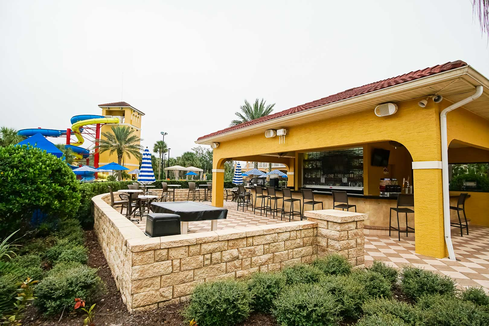 A quaint outdoor bar lounging area at VRI's Fantasy World Resort in Florida.