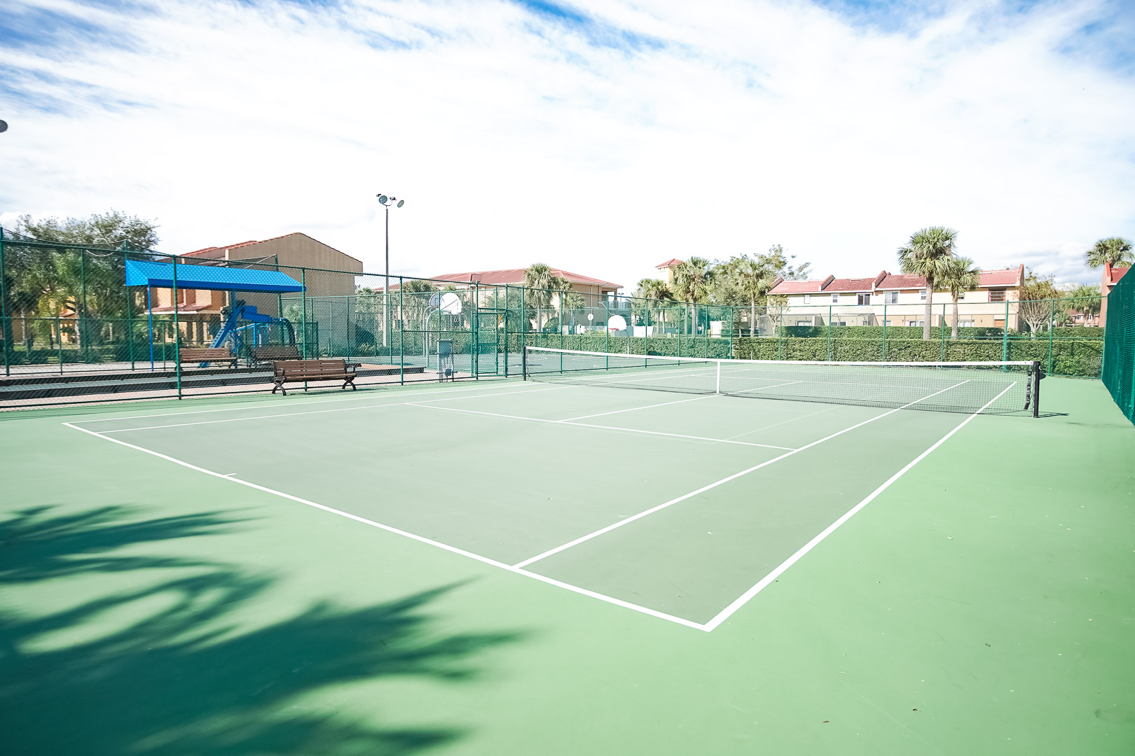 An expansive view of the tennis court at VRI's Fantasy World Resort in Florida.
