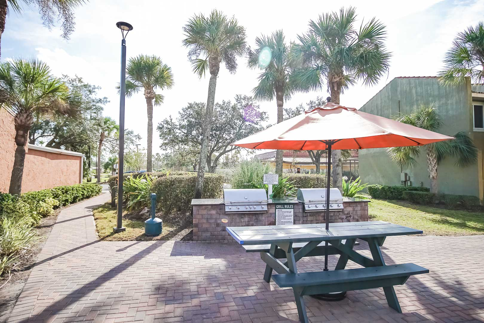 BBQ grills and sitting area at VRI's Fantasy World Resort in Florida.