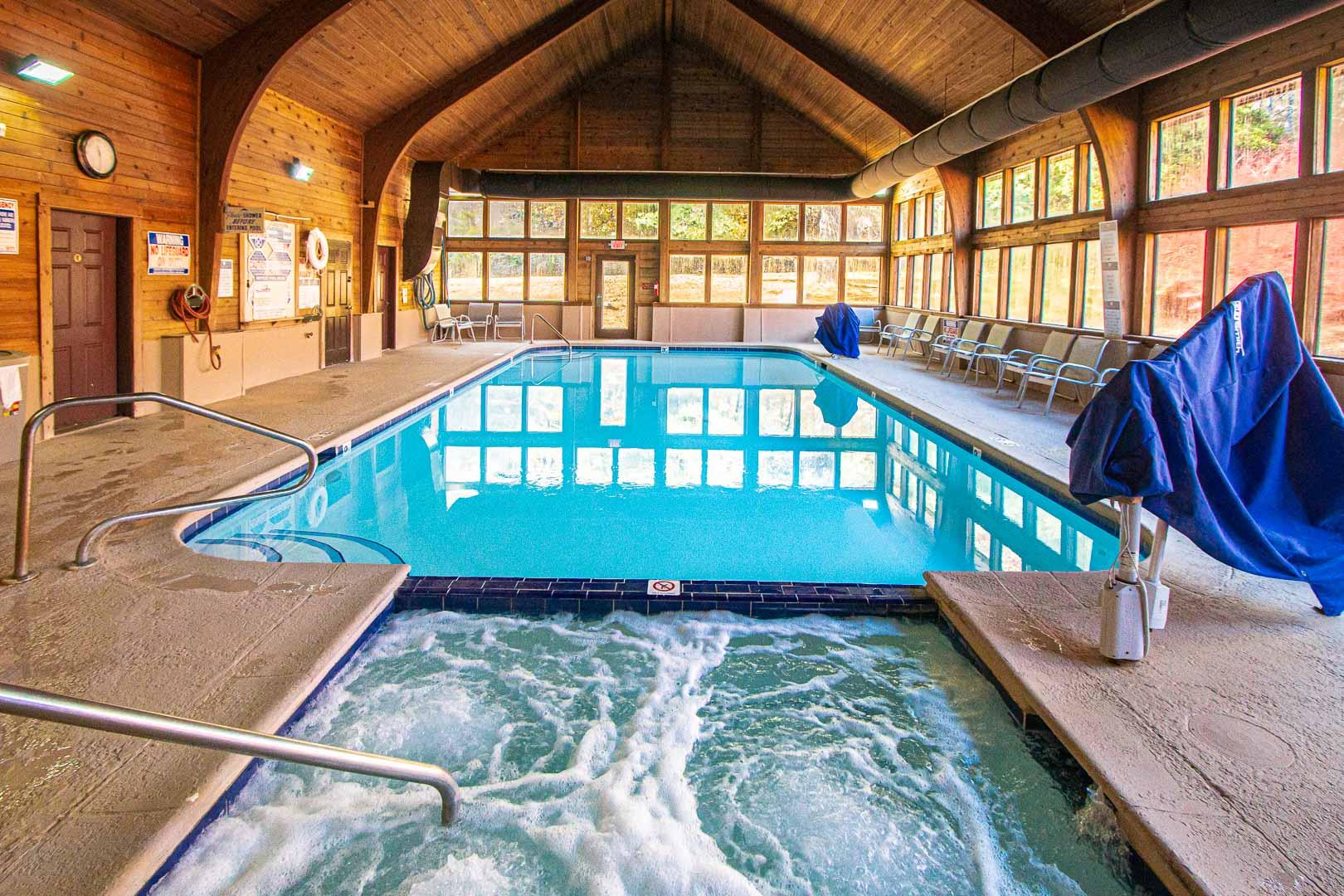 A quaint indoor swimming pool and Jacuzzi tub at VRI's Fox Run Resort in North Carolina.