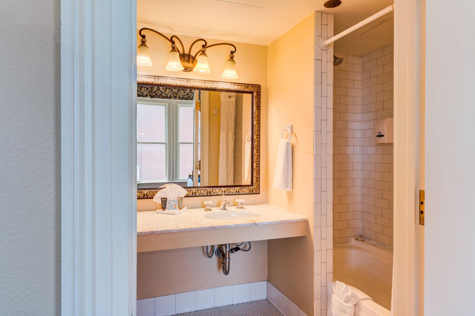 A clean bathroom at VRI's Gaslamp Plaza Suites in San Diego, California.