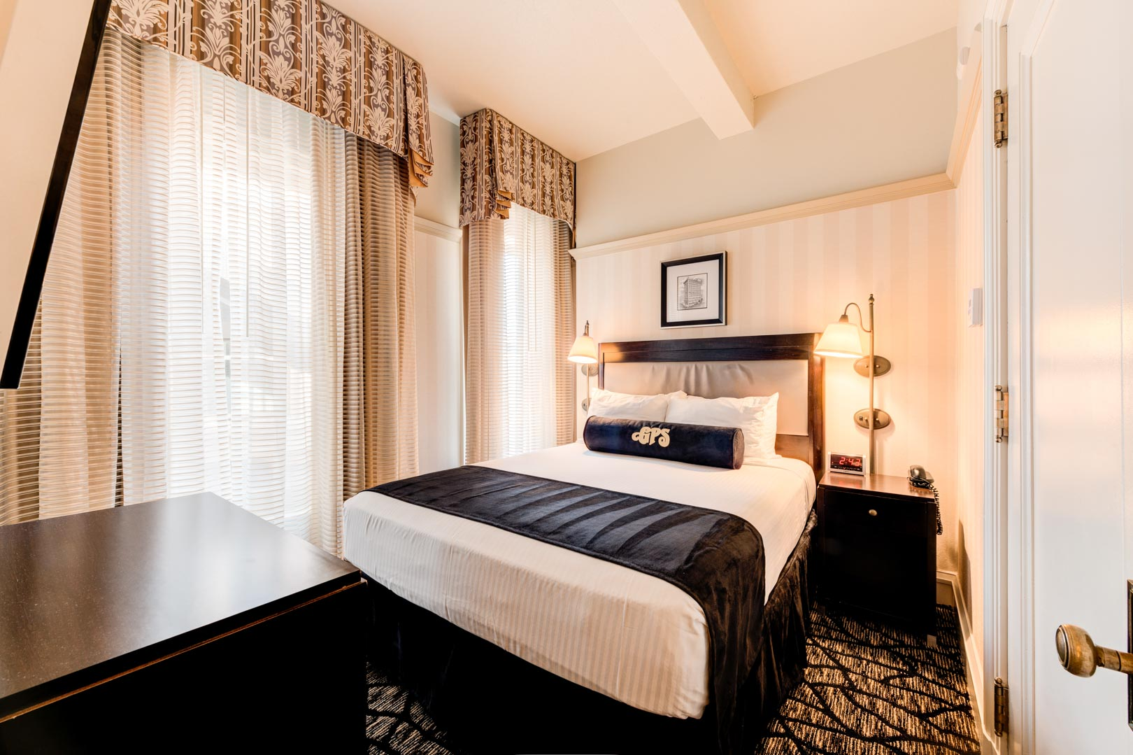 A charming master bedroom at VRI's Gaslamp Plaza Suites in San Diego, California.