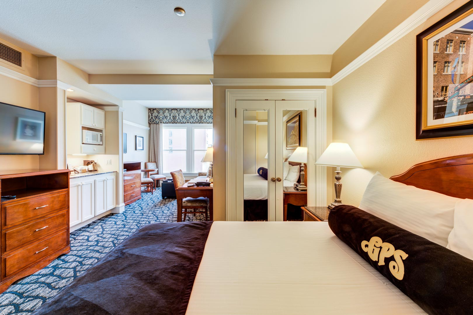 A charming bedroom at VRI's Gaslamp Plaza Suites in San Diego, California.