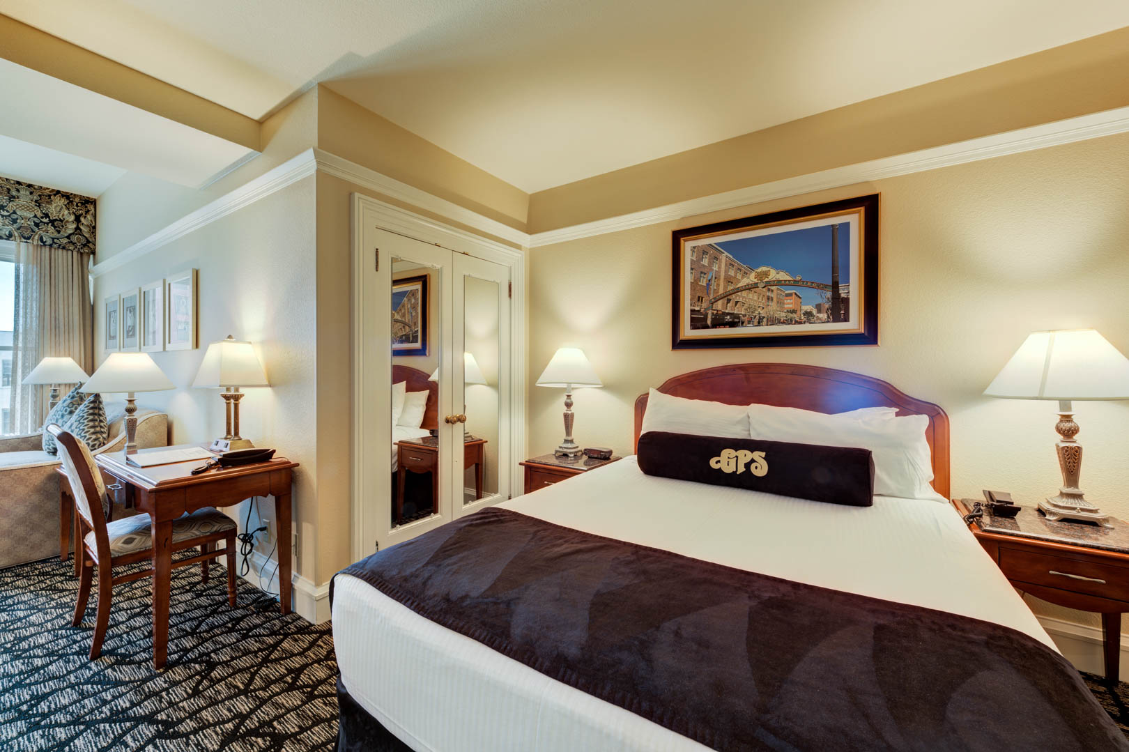 A charming master bedroom and living room area at VRI's Gaslamp Plaza Suites in San Diego, California.