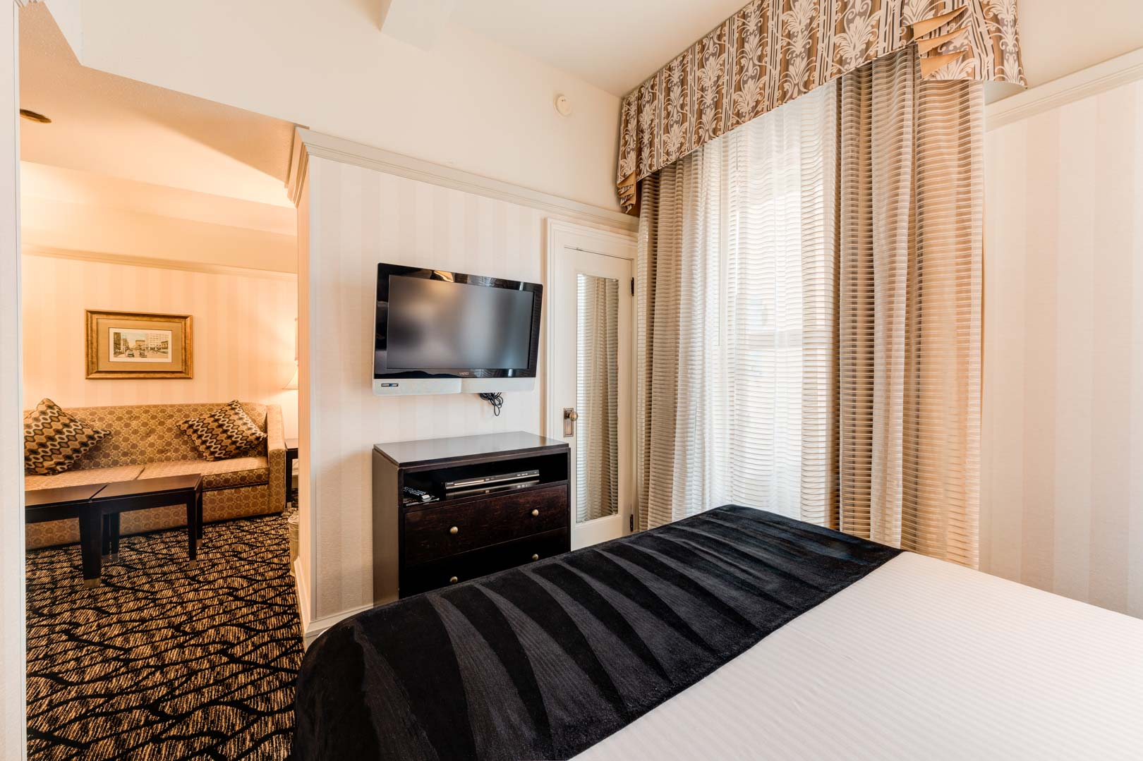 A renovated master bedroom at VRI's Gaslamp Plaza Suites in San Diego, California.