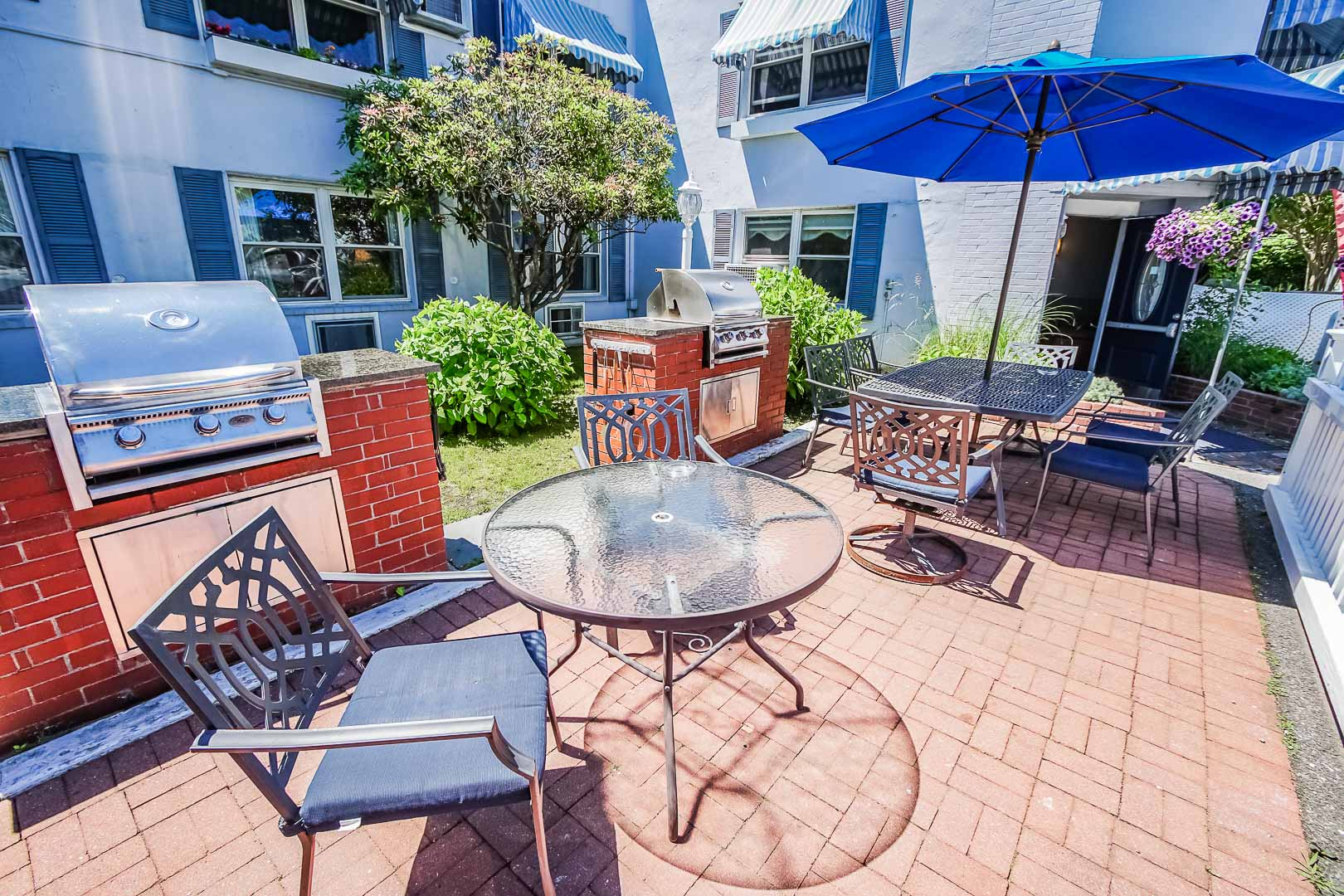 An inviting area with with BBQ Grills and tables at VRI's Harbor Landing Resort in Massachusetts.