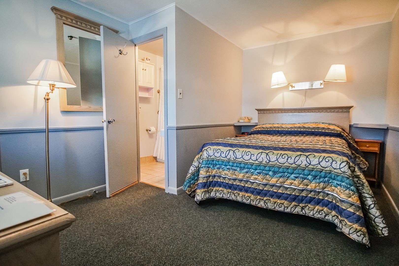 A cozy master bedroom at VRI's Harbor Landing Resort in Massachusetts.