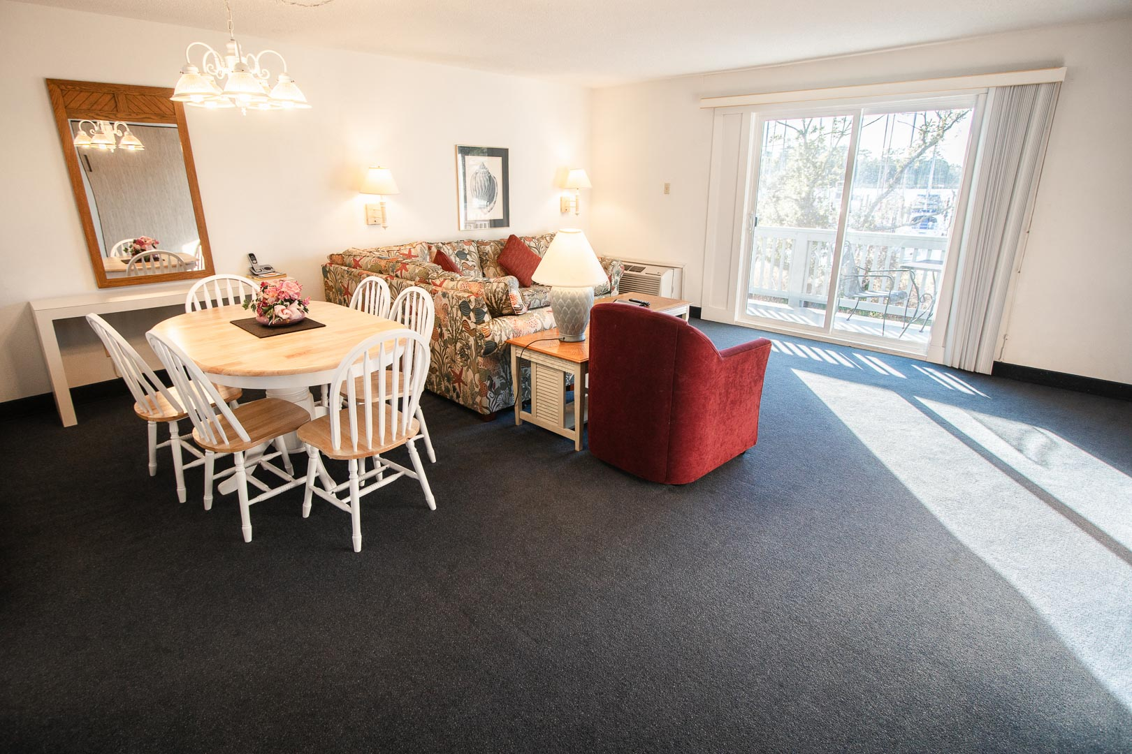 A spacious living room and dining table at VRI's Harbourside II in New Bern, North Carolina.