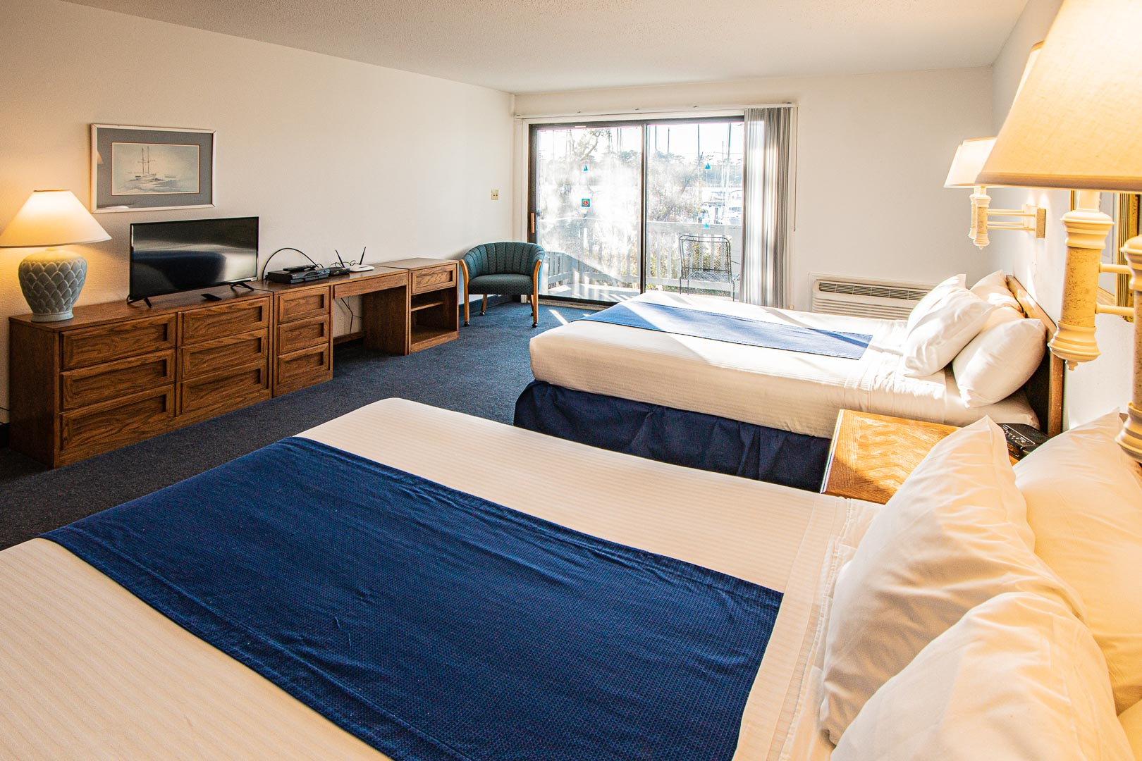 A spacious bedroom with double beds at VRI's Harbourside II in New Bern, North Carolina.