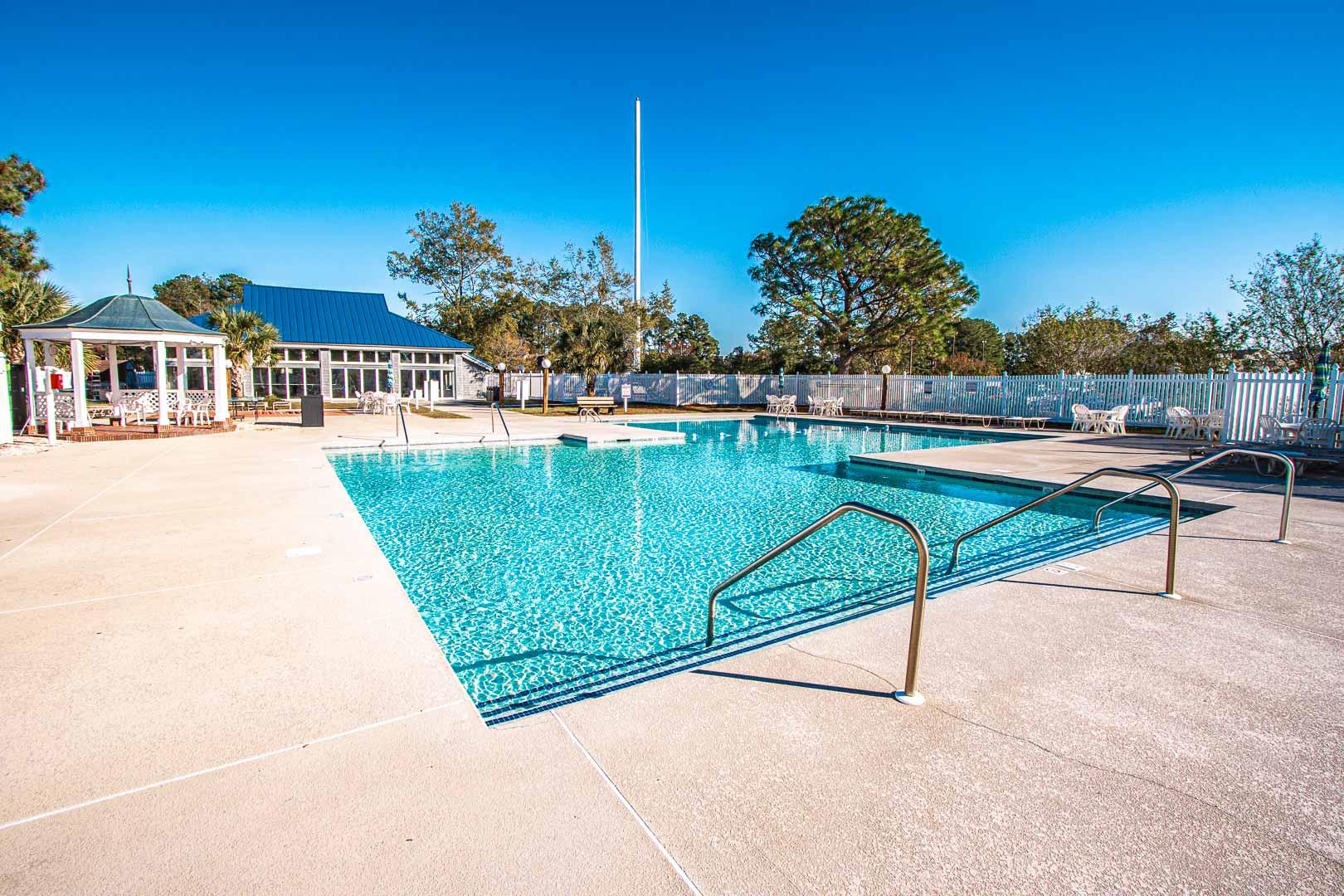 A spacious outdoor swimming pool at VRI's Harbourside II in New Bern, North Carolina.