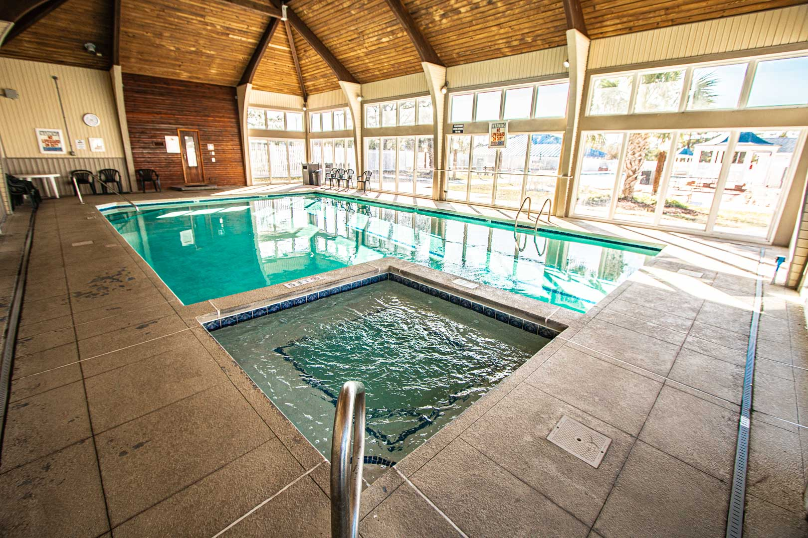 A stoic indoor swimming pool and Jacuzzi tub at VRI's Harbourside II in New Bern, North Carolina.