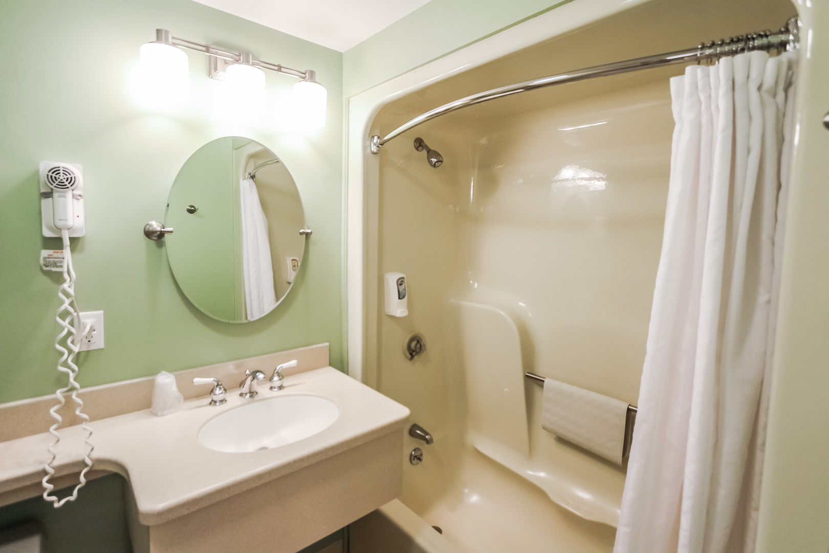 A spacious bathroom at VRI's Holly Tree Resort in Massachusetts.