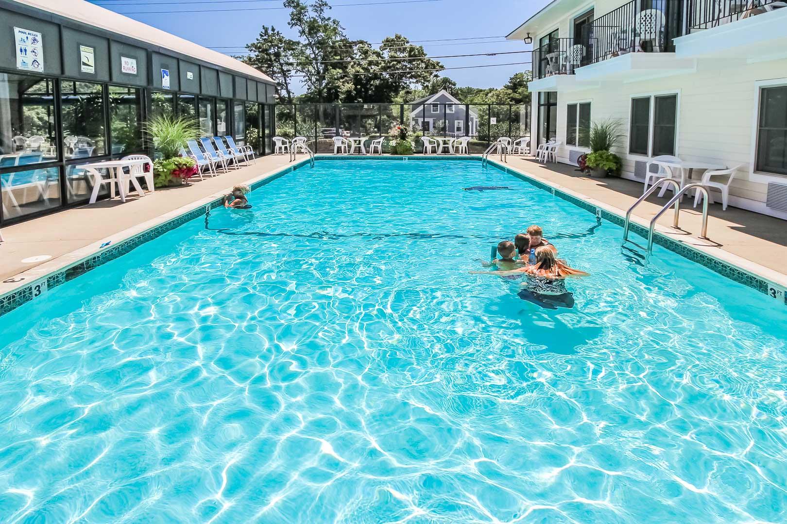 a refreshing pool at VRI's Holly Tree Resort in Massachusetts.