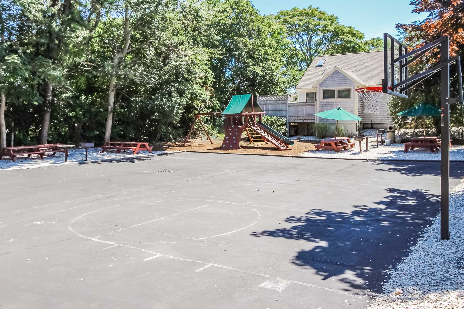 A spacious basketball court and playground at the Holly Tree Resort in Massachusetts.