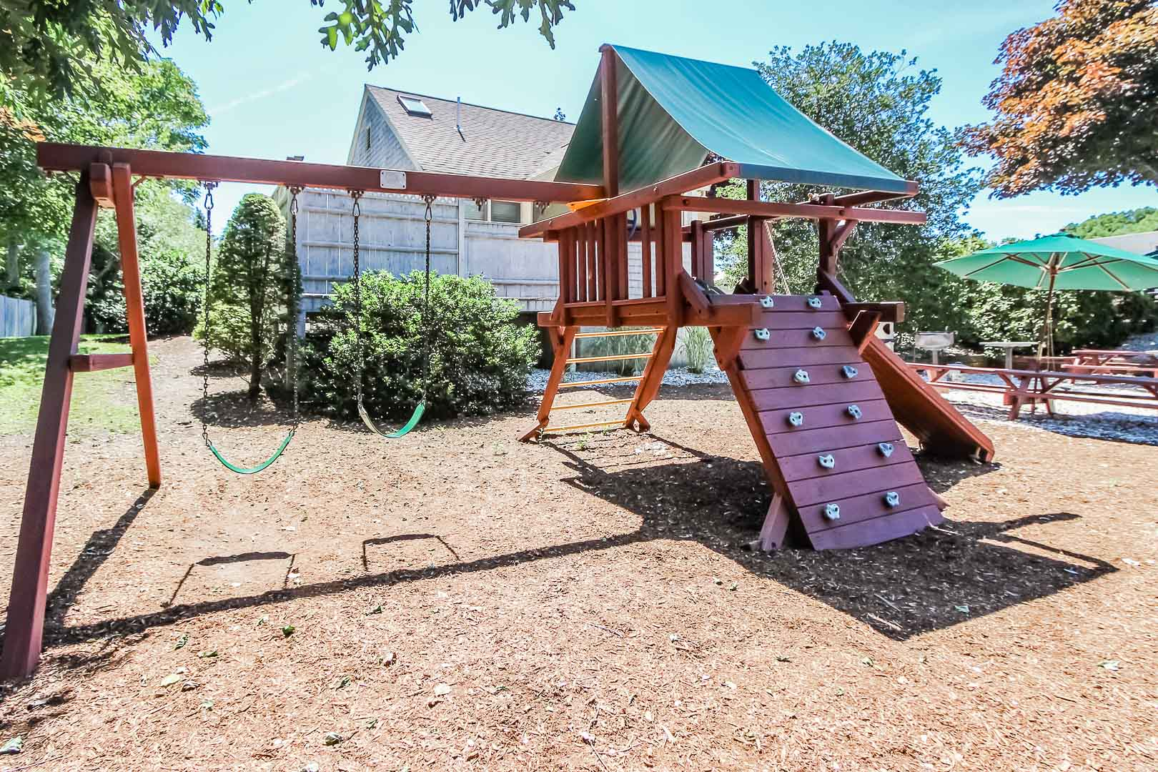 a charming playground for kids at VRI's Holly Tree Resort in Massachusetts.
