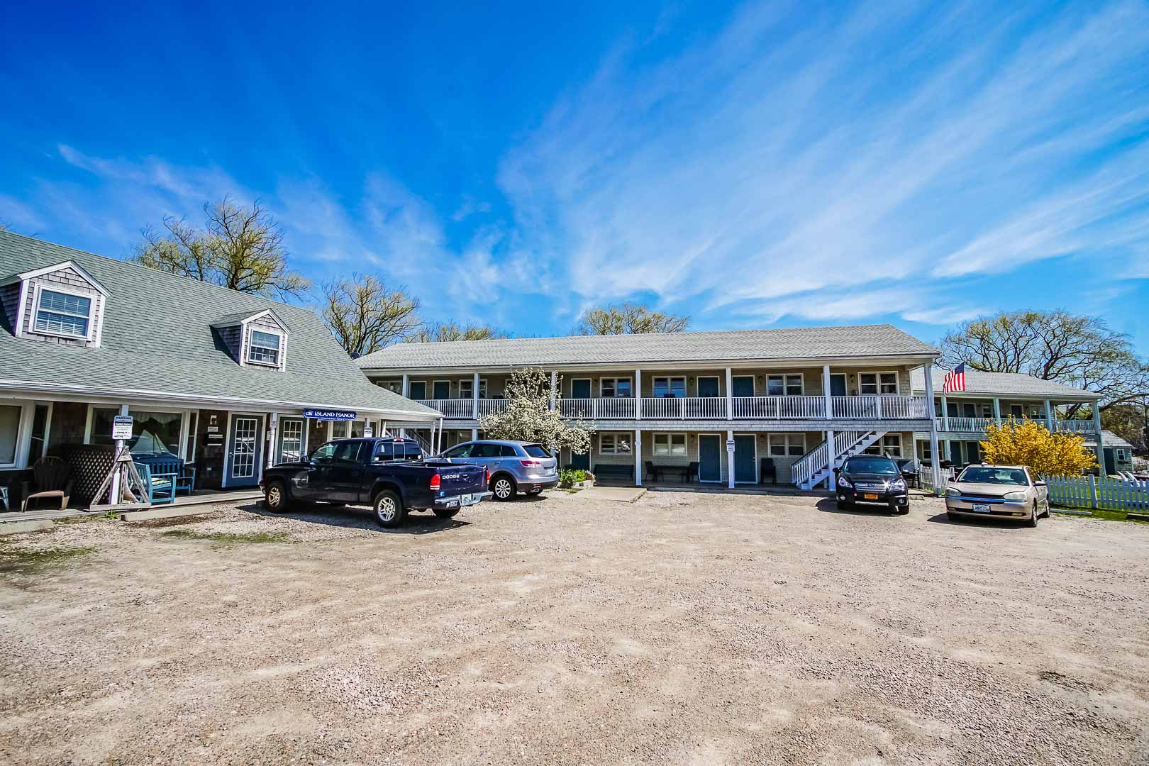 Clear skies and welcoming resort entrance at VRI's Island Manor Resort in Rhode Island.