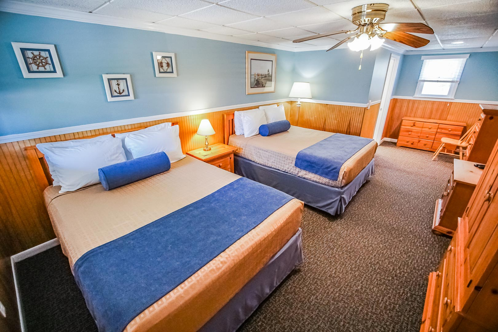 A spacious accommodation with double beds at VRI's Island Manor Resort in Rhode Island.