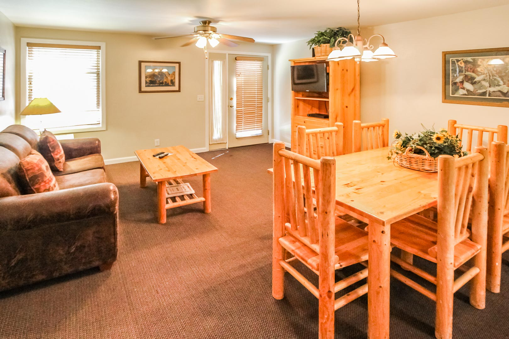 A cozy dining and living room at VRI's Jackson Pines in Wyoming.