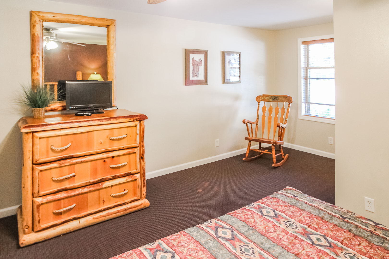 A furnished master bedroom at VRI's Jackson Pines in Wyoming.