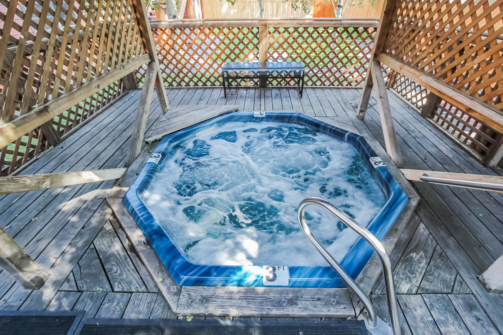 A relaxing outdoor Jacuzzi tub at VRI's Jackson Pines in Wyoming.