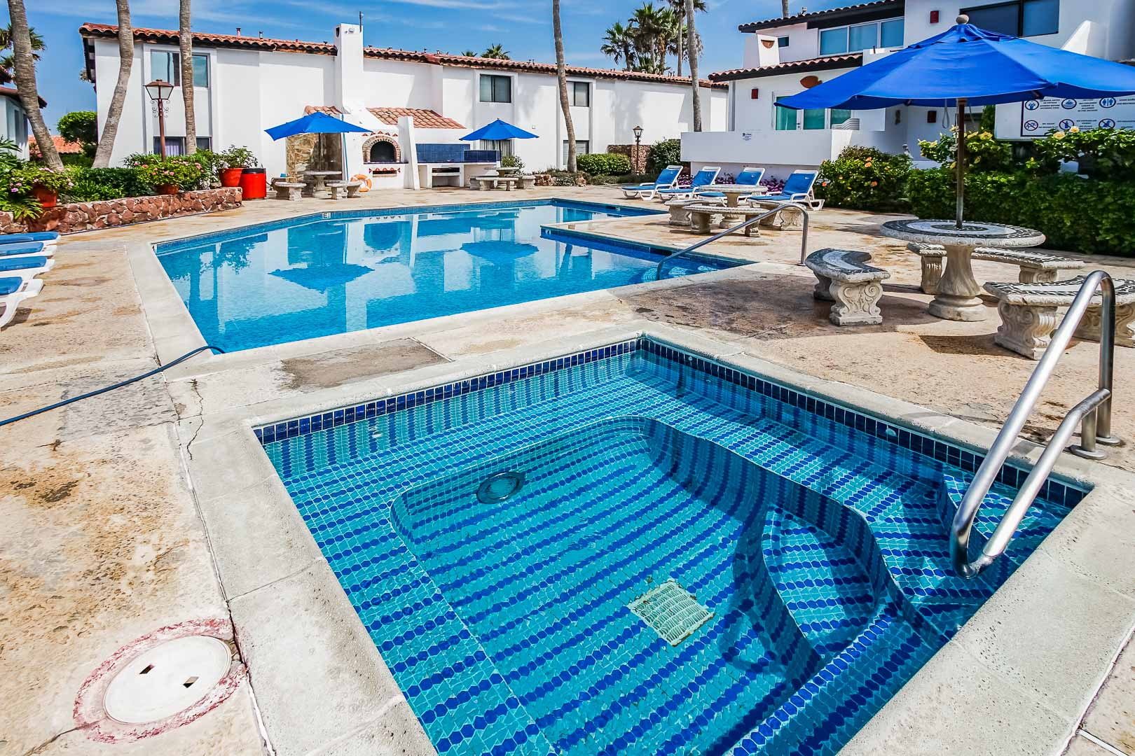A crisp outdoor swimming pool and Jacuzzi tub at VRI's La Paloma in Rosarito, Mexico.