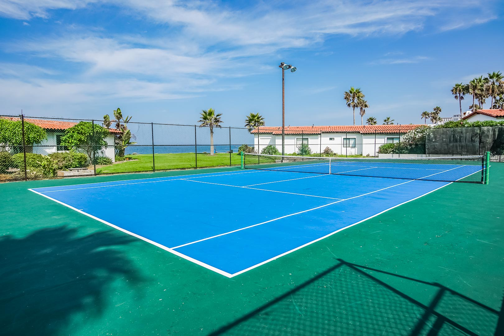 A vibrant tennis court by the beach A crisp outdoor swimming pool at VRI's La Paloma in Rosarito, Mexico.