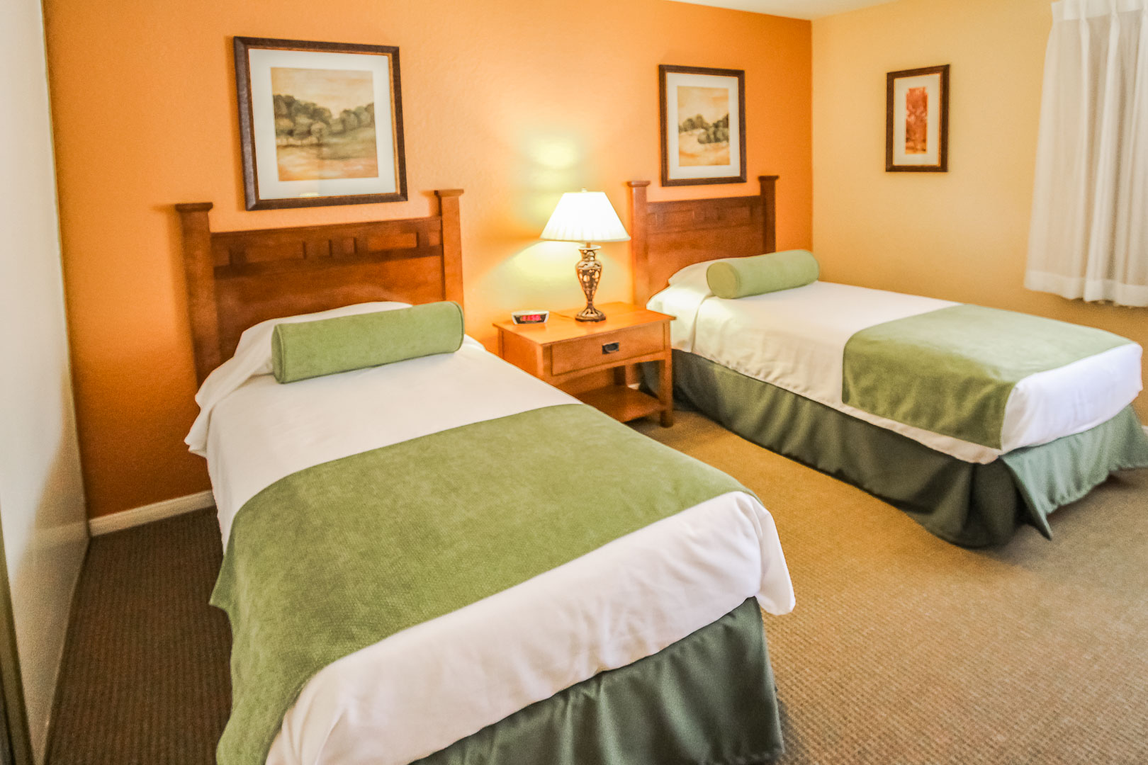 A cozy bedroom with double beds at VRI's Lake Arrowhead Chalets in California.