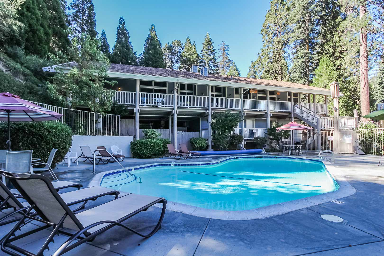 A peaceful view of the outdoor swimming pool at VRI's Lake Arrowhead Chalets in California.
