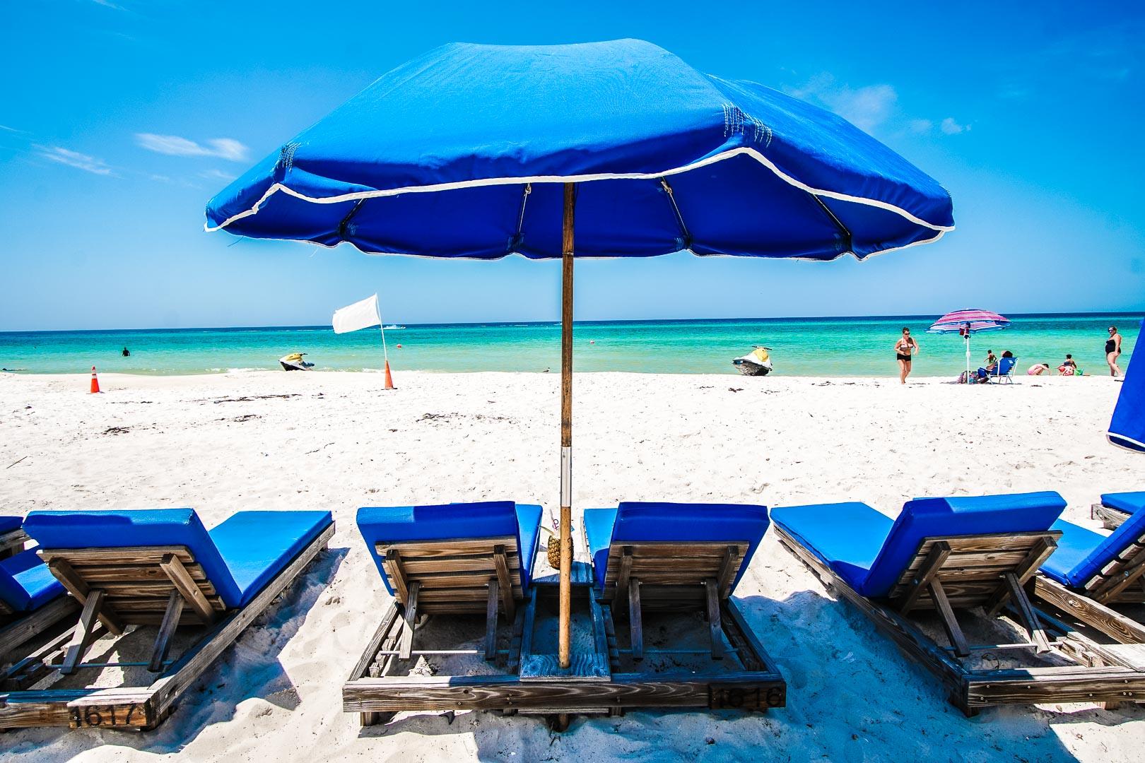 Beach chairs by the beach at VRI's Landmark Holiday Beach Resort in Panama City, Florida.