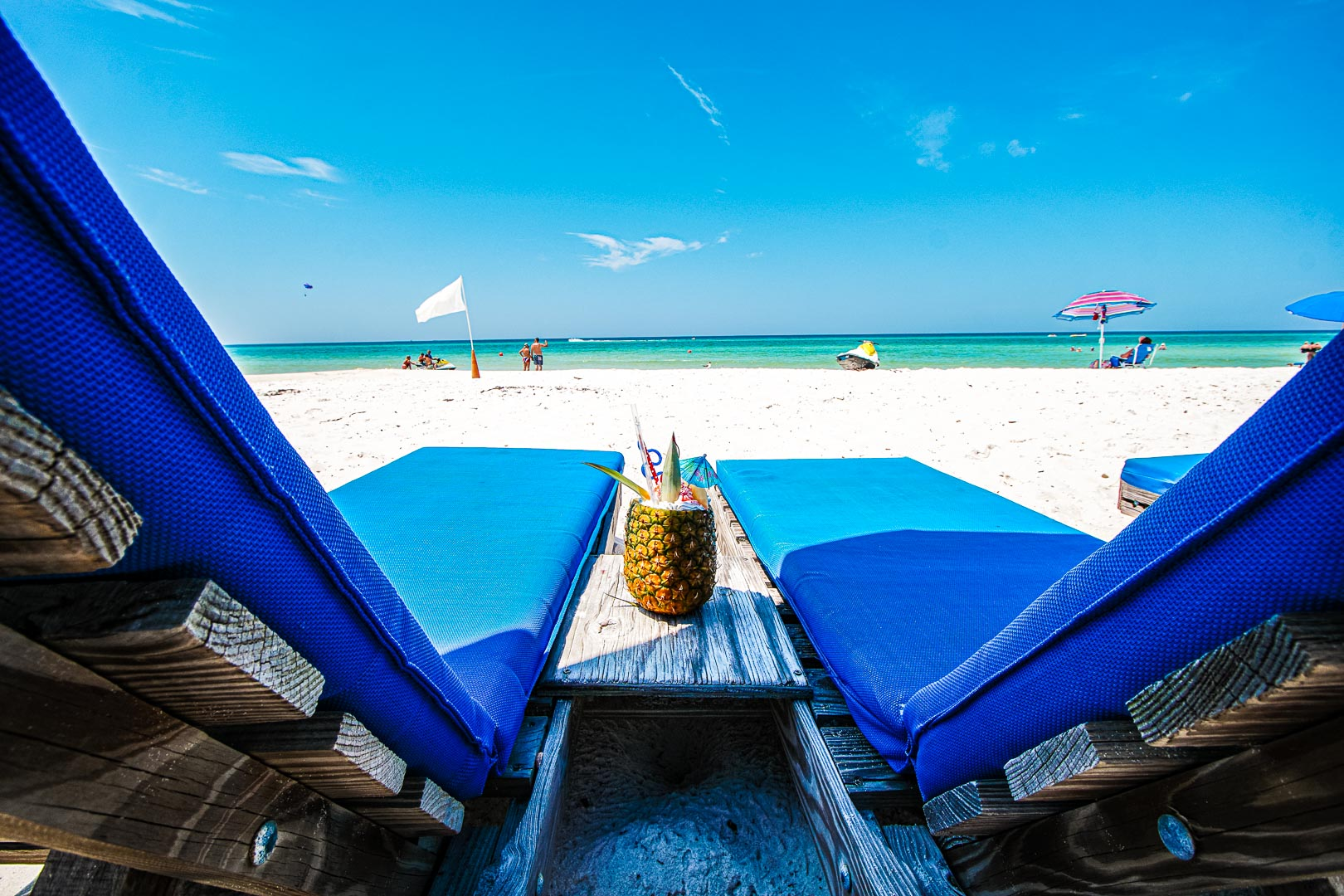 A relaxing view of the beach and a pina colada at VRI's Landmark Holiday Beach Resort in Panama City, Florida.