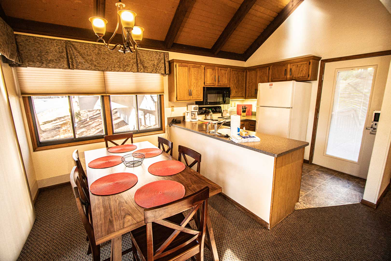 A spacious dining and kitchen area at VRI's Mountain Loft Resort in North Carolina.