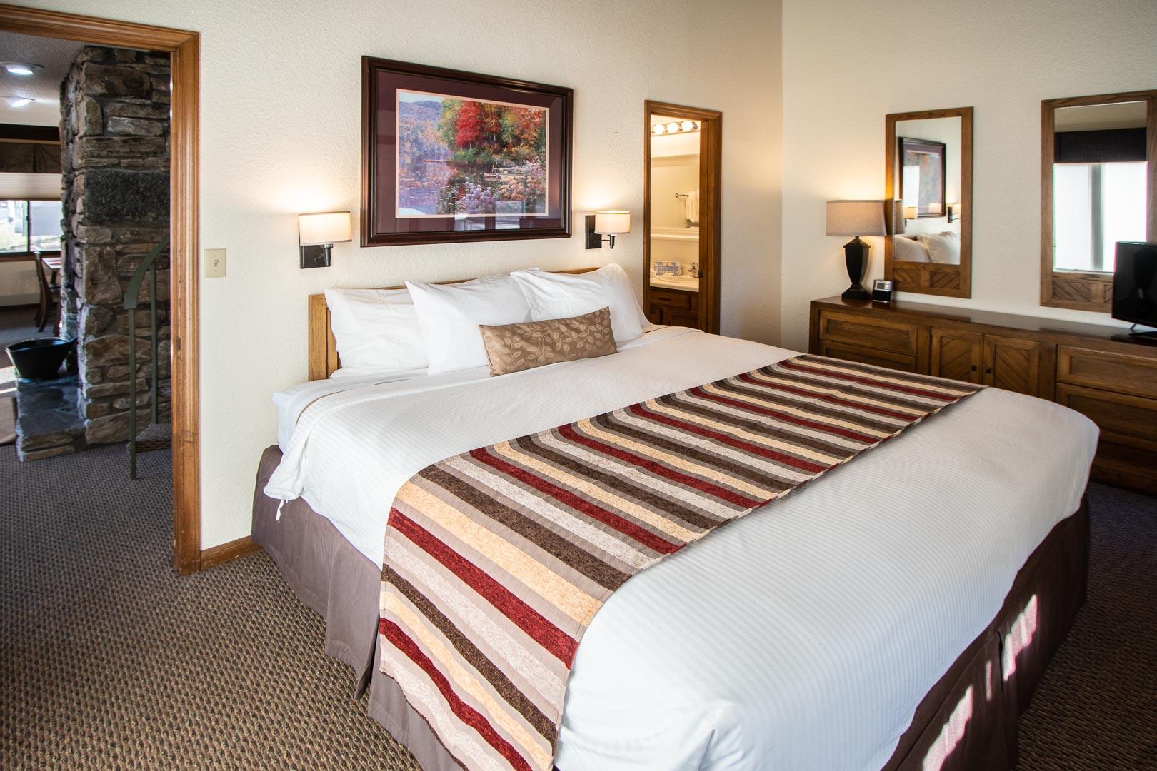 A spacious master bedroom at VRI's Mountain Loft Resort in North Carolina.