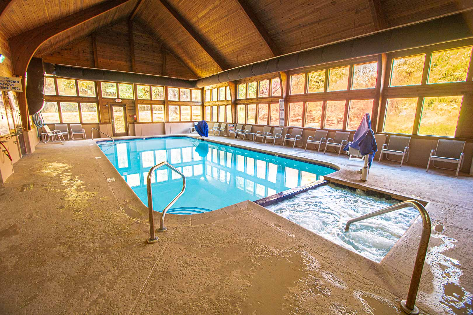 A spacious indoor swimming pool and Jacuzzi at VRI's Mountain Loft Resort in North Carolina.