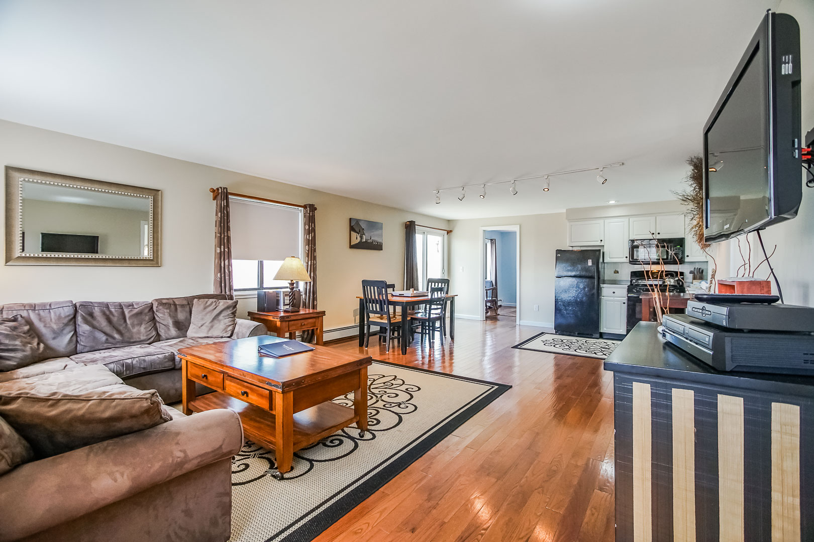 A spacious living room area  at VRI's Neptune House Resort in Rhode Island.